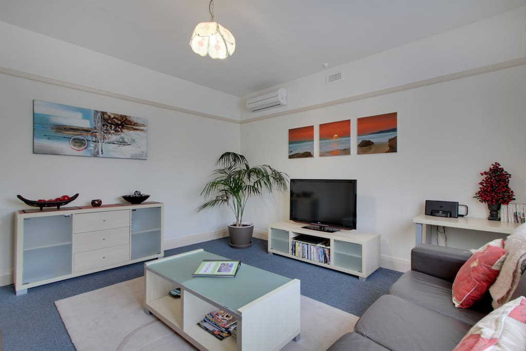 Large formal lounge with large TV, DVD player and DVD library