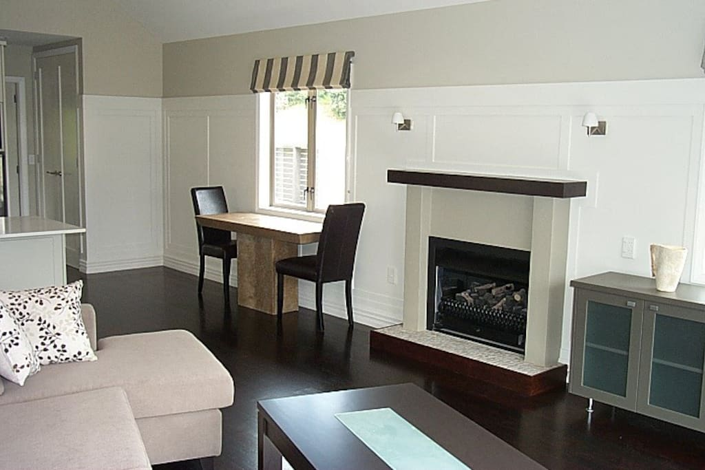 The open plan lounge with gas fire and heat pump