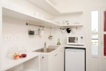 The Kitchen is equipped with: - Microwave - Two eye stove - Nesspresso Machine - Fench Press  - Toaster Grill