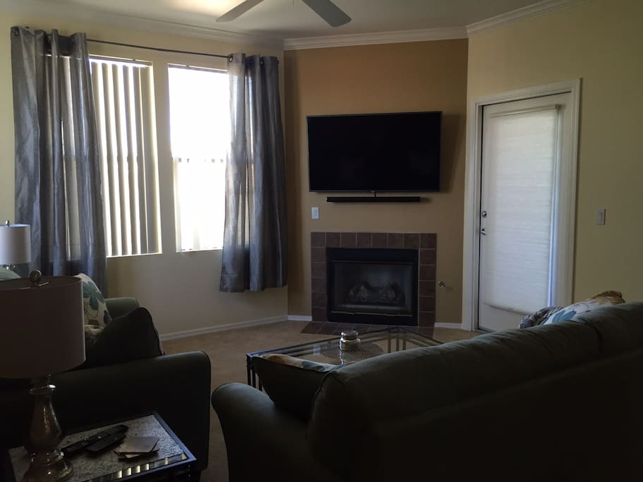 "Living room with gas fireplace and 55"" TV, Netflix, Hulu, Amazon and other apps available!"