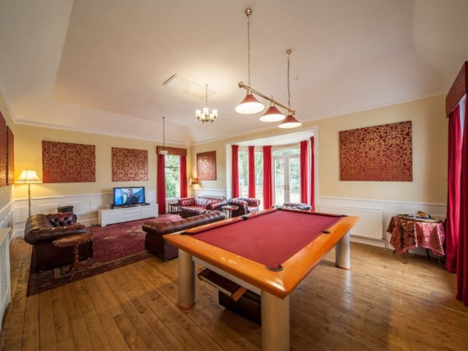 Relax with family in this beautiful room, will plenty of sofas, tv, dvd and pool table