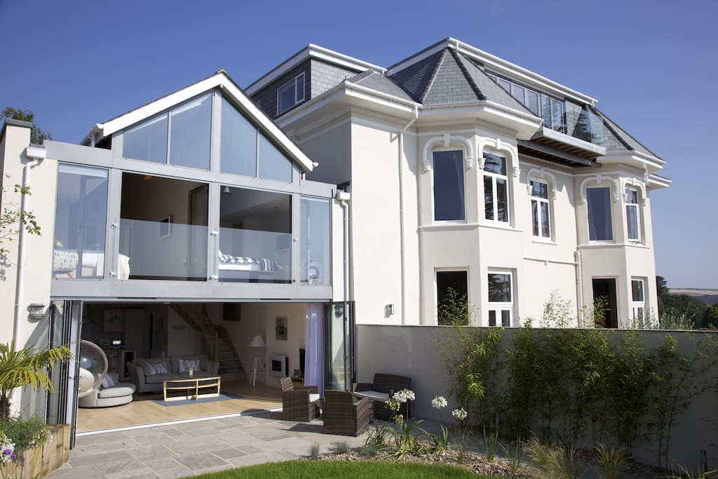 The Gorgeous Glasshouse - its the lovely house on the left with the bi-folding doors.