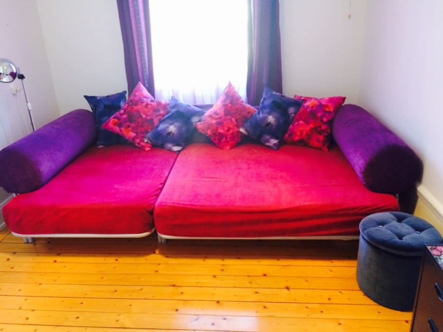 Big comfortable bed-sofa (1,6*2,3 m) with a thick bed-mattress on the top; large charming colorgul room; airbed can also be provided if there are more then 2 persons checking in (kids, other friends)