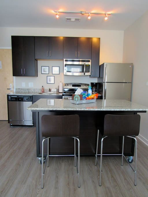 The granite countertop island with wheels and barstools included