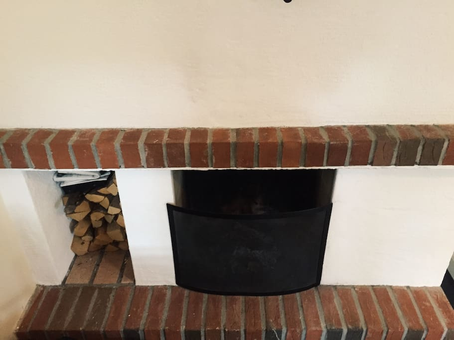 A small and cozy fireplace.