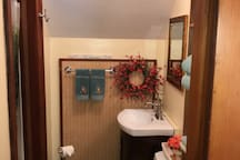 Second floor full bathroom Pedestal sink & shelving with fresh towels provided
