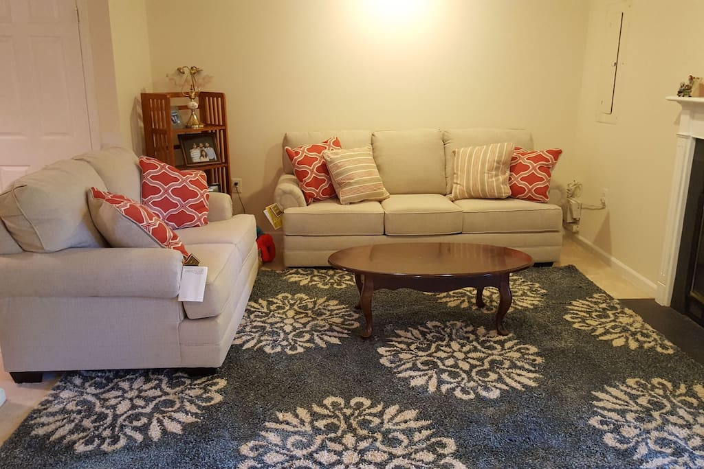 Rent this spacious basement studio with convertible sofa bed. Private bathroom, and shared kitchen.