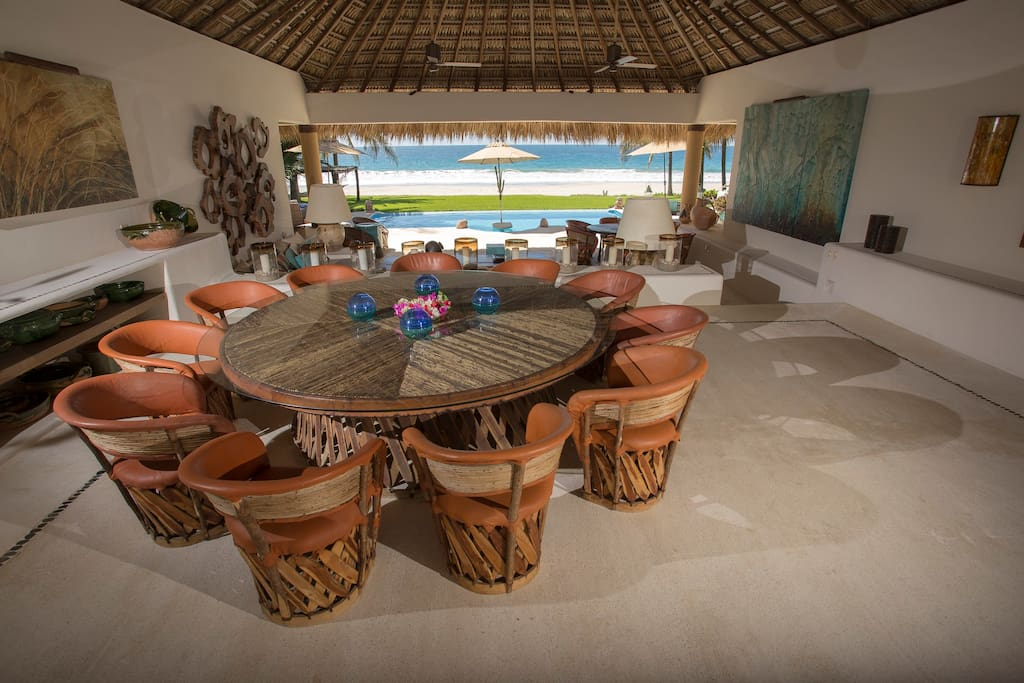 Dining area overlooking the living room with view of the ocean