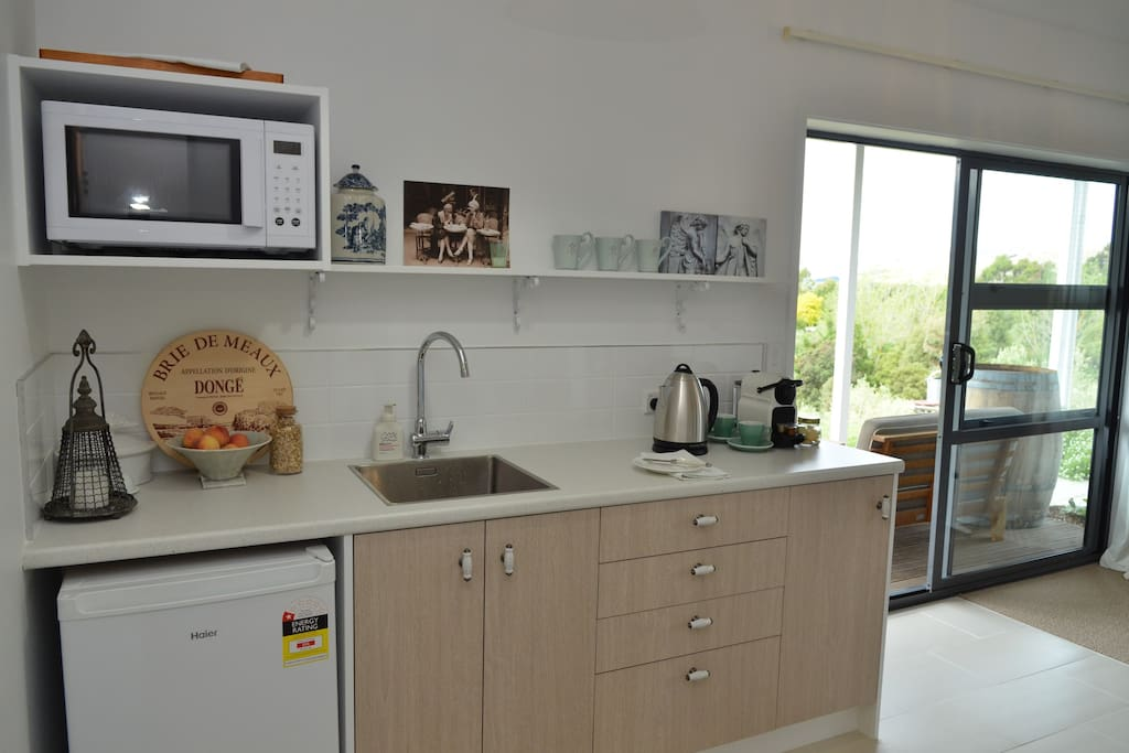 Kitchenette comprising of microwave, fridge, nespresso machine, range of teas, milk and complimentary home made muesli provided.