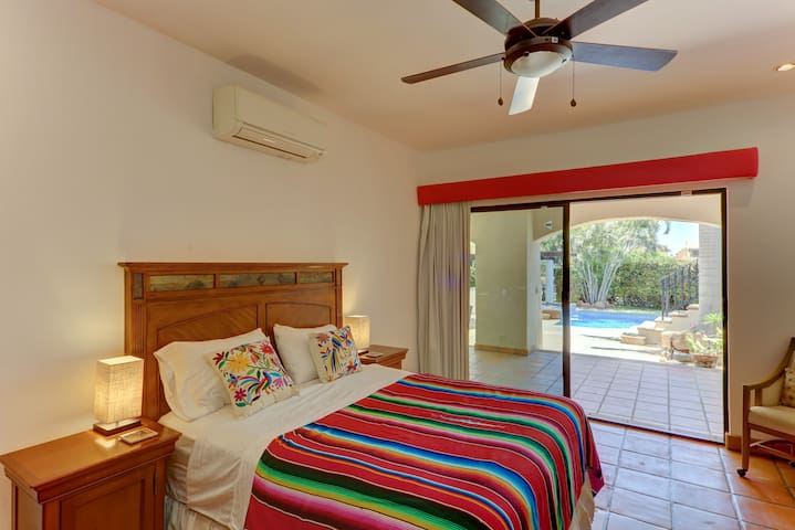 Easy poolside access through big sliding glass doors with Mexican Otomi art styled decor.
