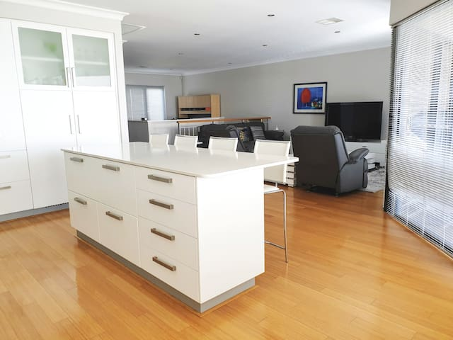 Stay in The Residence at Rockingham, WALK TO BEACH