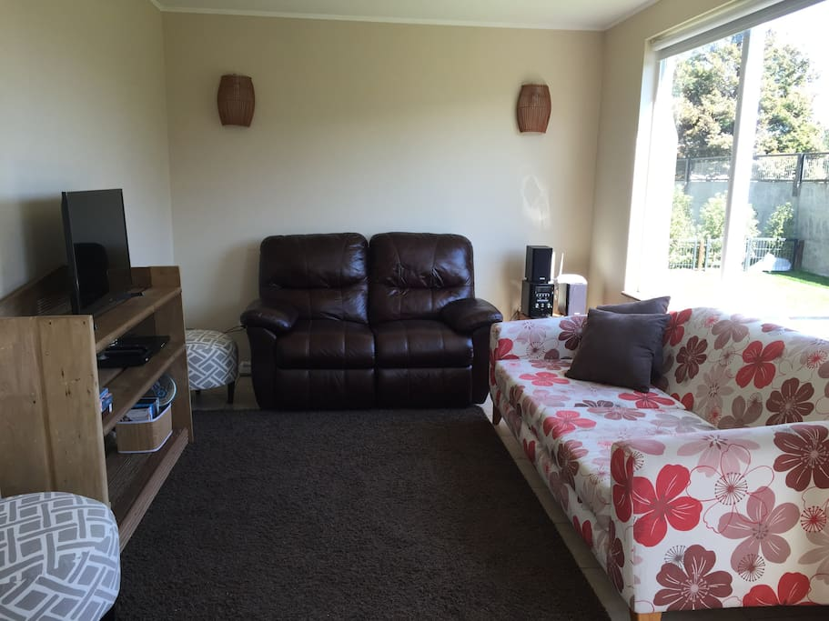 Fully equipped Living room with armchairs, smart tv, DVD and stereo