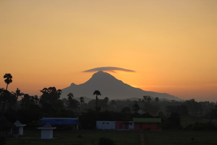 Sunrise over the glorious Mt Arunachala View from Guest Houses