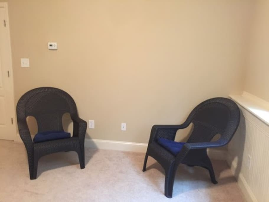 The chairs and the spacious room provide a homely environment.