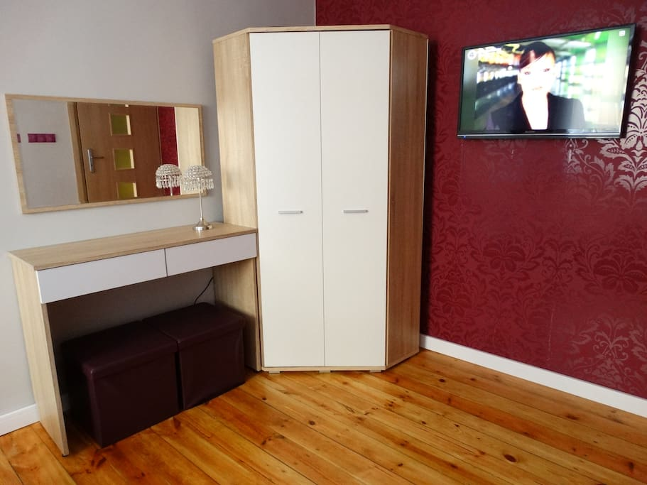 spacious wardrobe and a dressing table