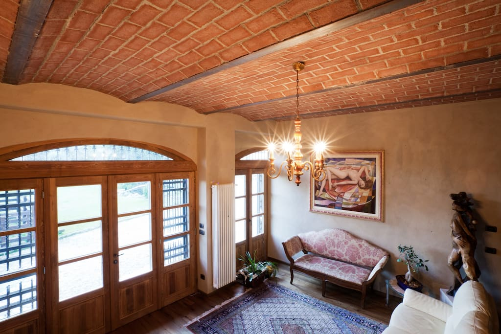 the living room with a brick ceiling