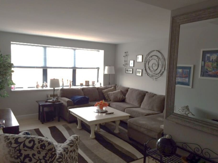 "Bright, Spacious Living Area with 55"" Smart TV, Comfortable Seating for 6"