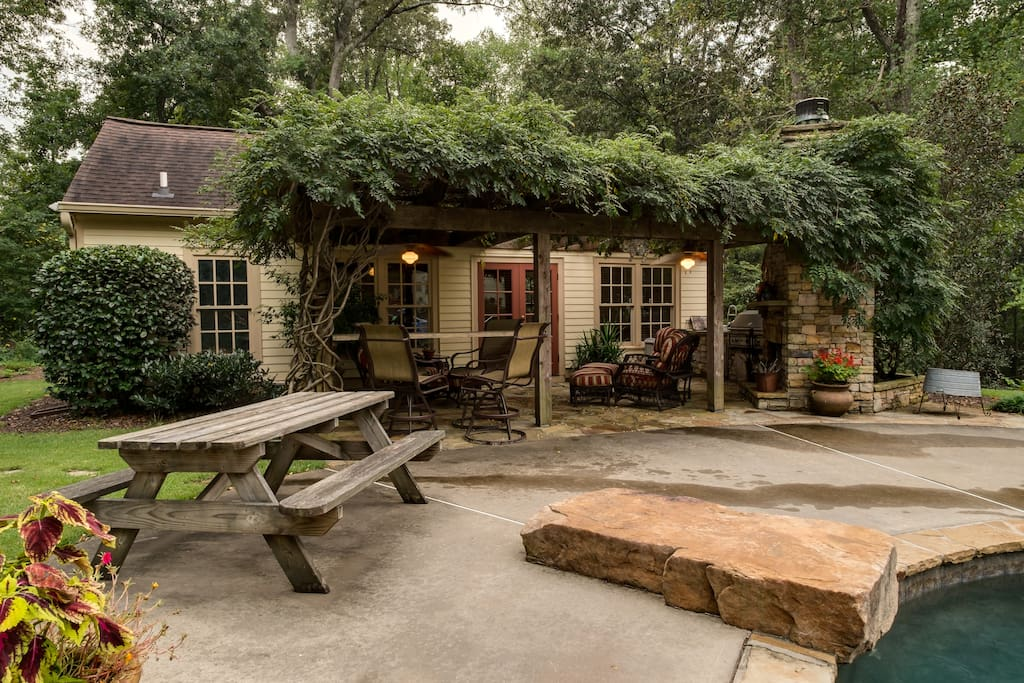 Arbor covered patio with picnic and seating areas.
