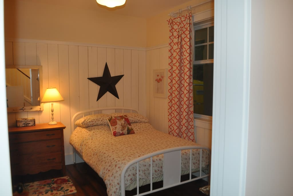 Relax in our cozy vintage farmhouse - inspired bedroom.