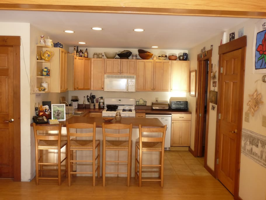 Full kitchen w/extra overflow  fridge in utility room
