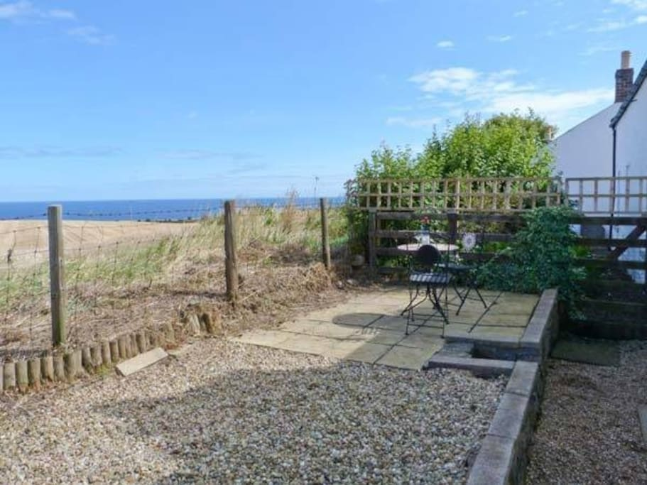 Back Garden with terrace with outside seating and amazing views to the sea,