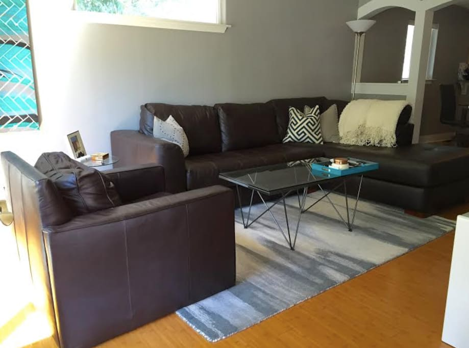 Family room with new couch and table. Plenty of room for 6 to sit comfortably.