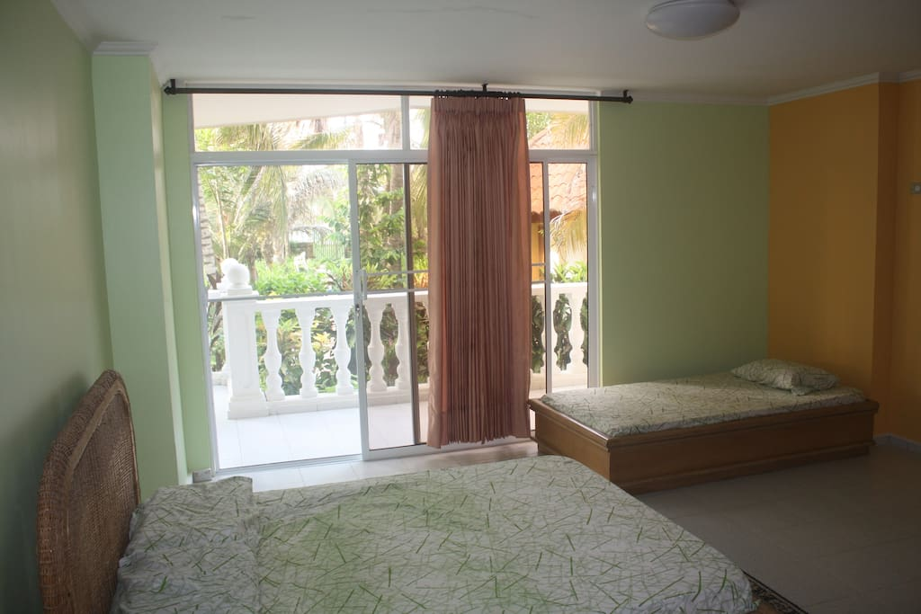 Room #1 - Private double with full, in-suite, bathroom (extra single bed can be placed/removed depending on your needs.)