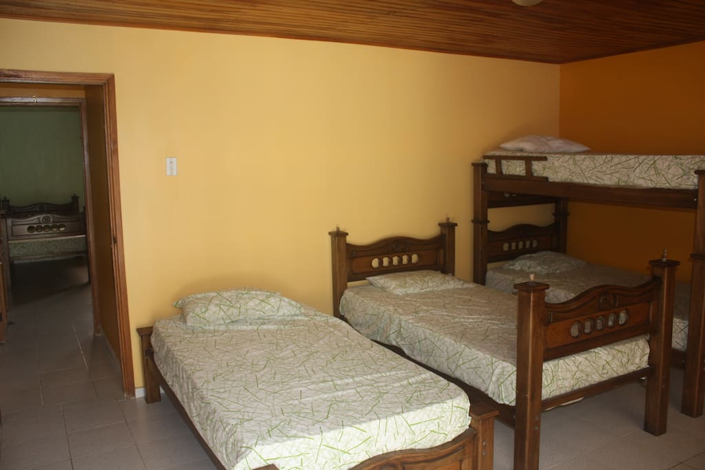 Room #4 - Shared room (4 single beds) with full, in-suite, bath.