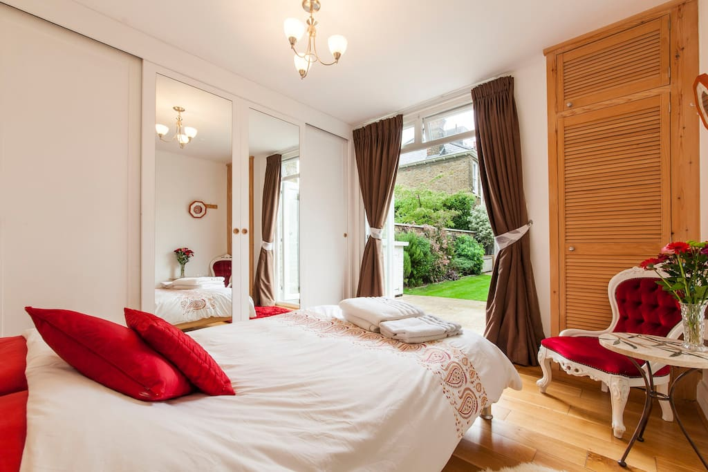 Master bedroom with French doors opening up to the private garden.