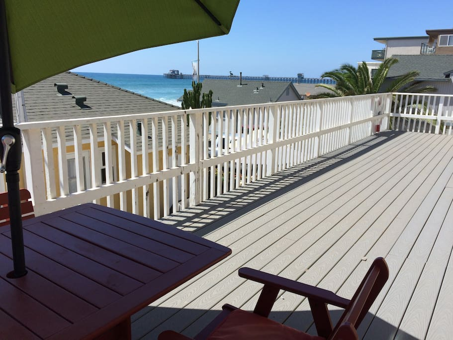 The apartment opens out to a nice ocean view deck with the pier in sight.  Patio table with umbrella.