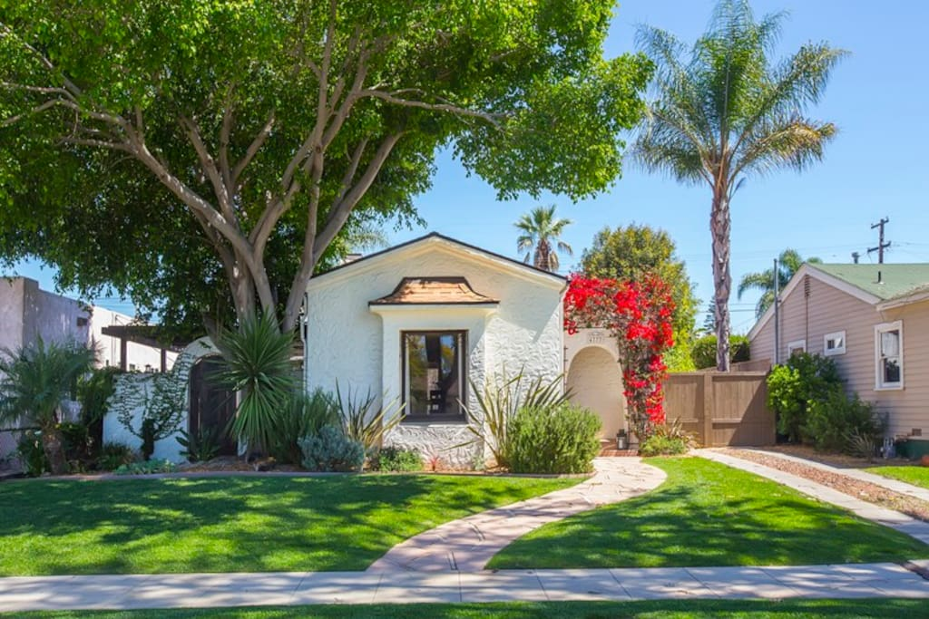Gorgeous spanish style bungalow on tree lined street in family friendly neighborhood.