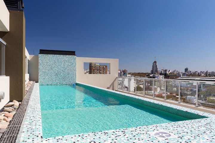 Shared rooftop pool with jacuzzi