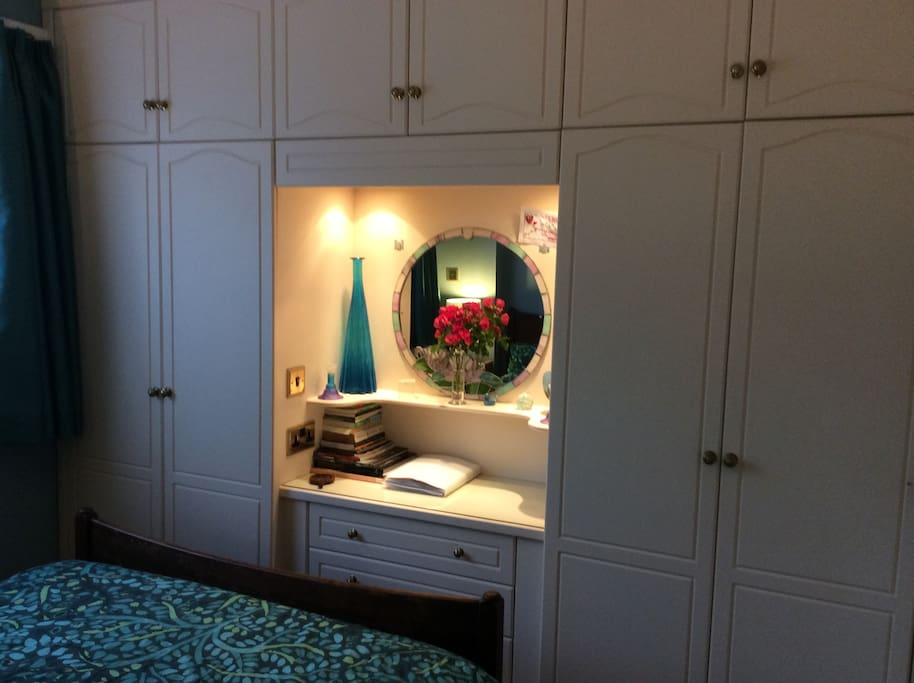 The bedroom is not huge, but is not cramped. You will have an empty cupboard to hang your clothes/stash your case, and an empty drawer in the bedside table.
