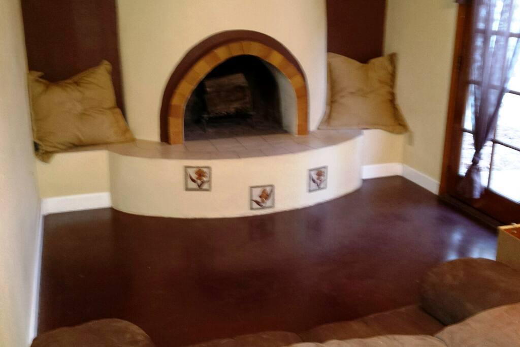 Sunroom fireplace area.