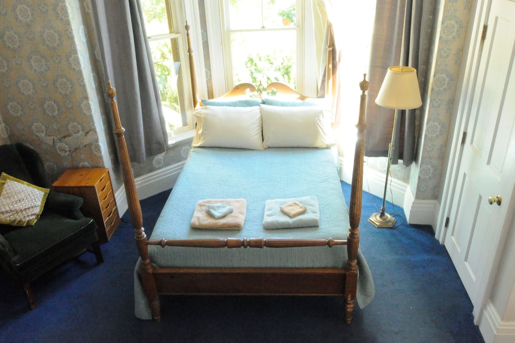 The bedroom, with a brand new Tuft & Needle mattress. The bed sits right by the bay window.