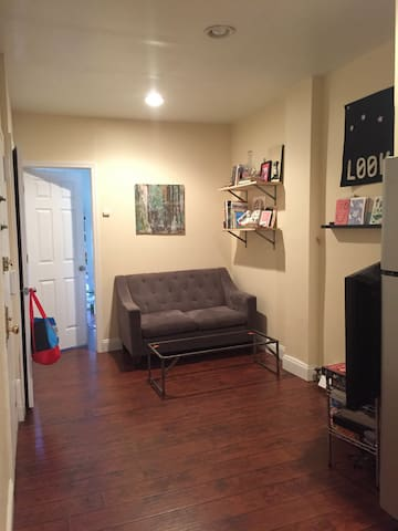 Living room is small but has a huge TV.