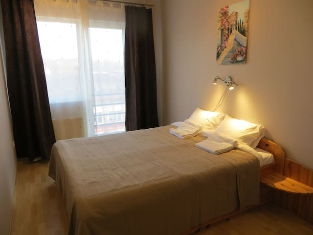 Bedroom has one large bed 200*160 which is really comfortable to sleep in. The bed has extensions on both sides to put your book you just read. There are wall outlets also nearby for charging your phone.