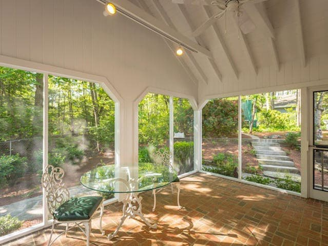 Amazing screened in porch with outdoor sofas and table. Hang hammocks from the rafters and it's like indoor camping.