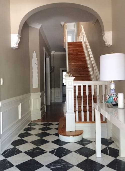The entryway is gracious and spectacular - sweeping views to the upstairs with an easy spot to deposit bags and change shoes.