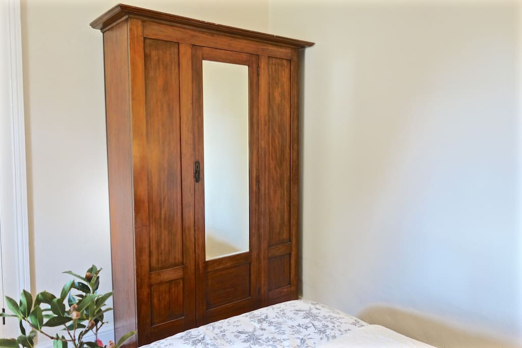 The first bedroom has a beautiful antique mirrored wardrobe.