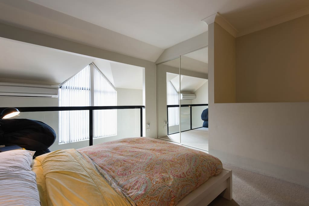 Double bed with loft window.