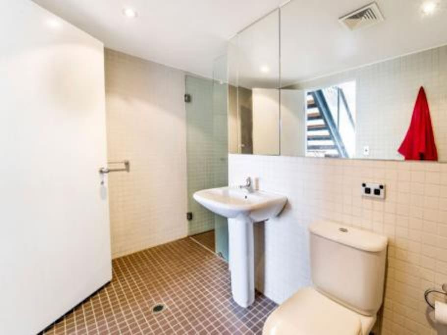 Mosaic bathroom with shower and bath