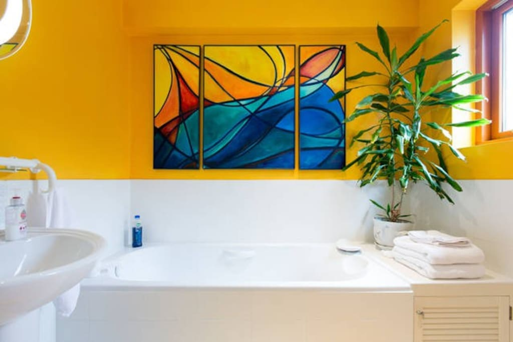 You have exclusive use of a large bathroom with separate shower -- and original art work!