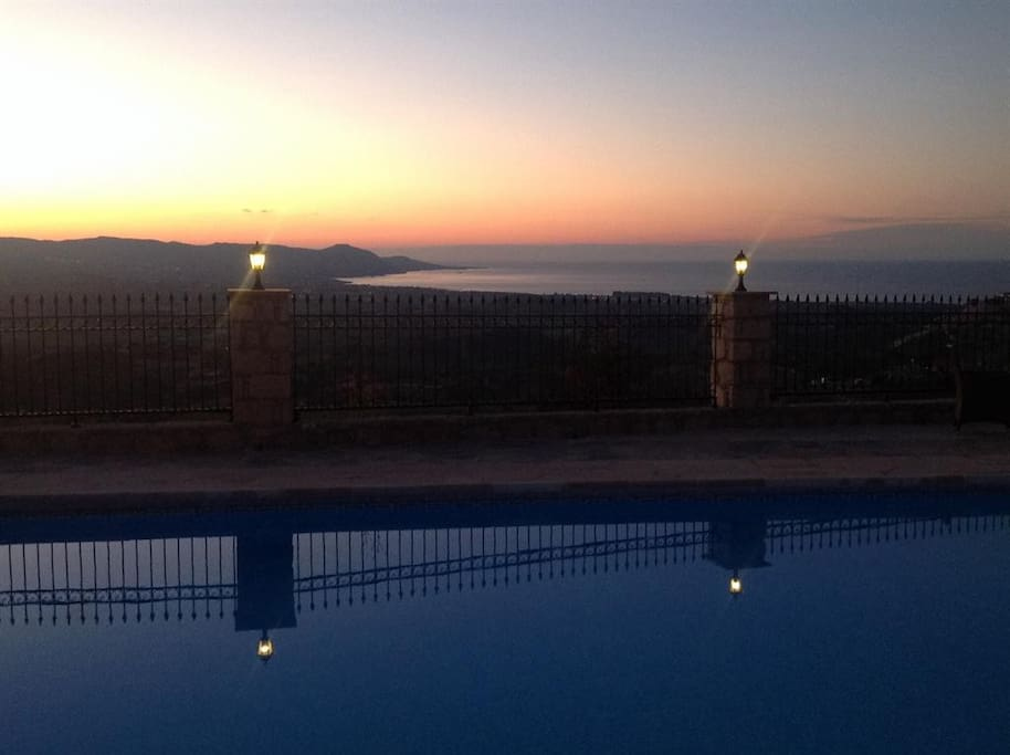 Sunset over the pool and the sea.