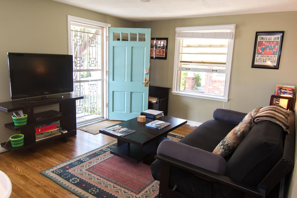Living room with door and windows open to let in the fresh breeze.
