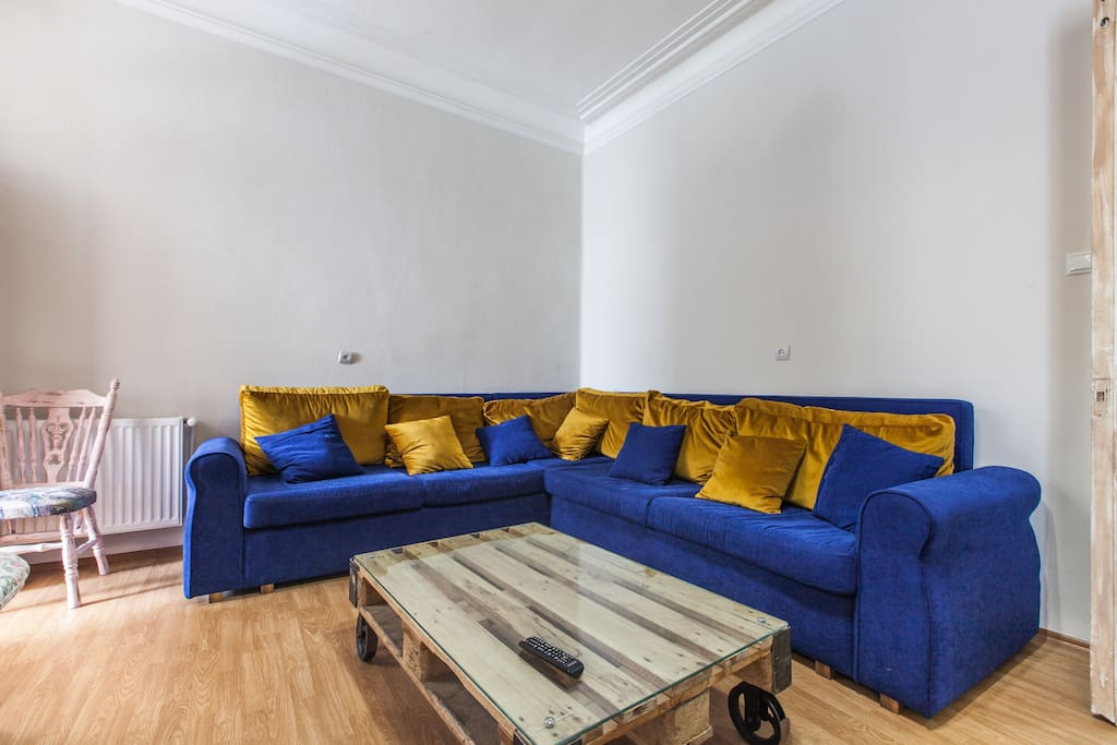 Living room, it has a sofa that has a bed inside it, there is Flat screen TV, wi-fi, AC