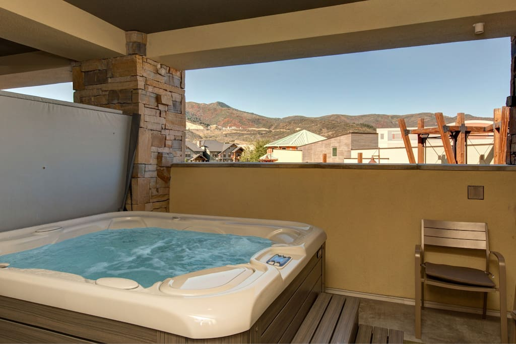 A peek at the mountain peaks from the private hot tub!