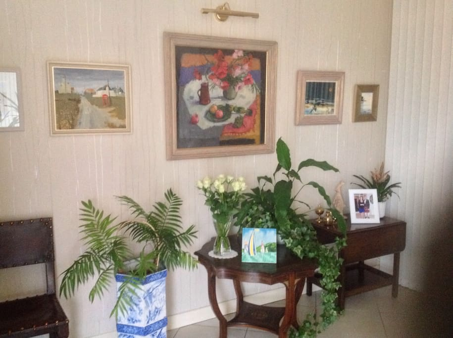 Original art and floral arrangement in our spacious entry hall.