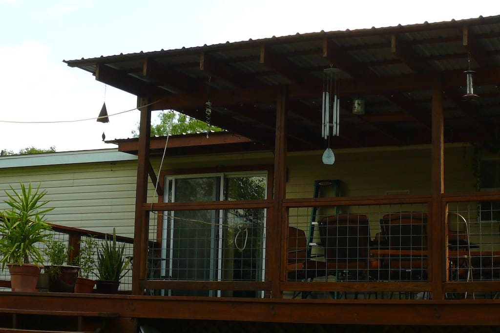 Beautiful back porch to relax, have a drink, greet the day