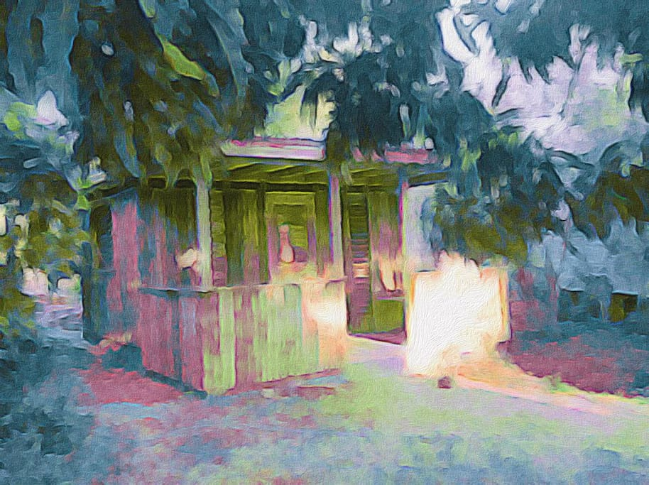 Mango Watch Cottage: an artist's watercolor entrance and veranda